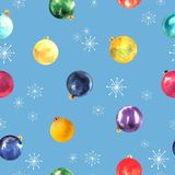 Seamless pattern of colorful watercolor Christmas balls on blue background.  stock illustration