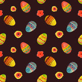 Seamless pattern with colorful watercolor Easter eggs and flowers on black background Royalty Free Stock Images