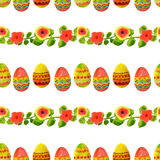 Seamless pattern with colorful watercolor Easter eggs, green leaves and flowers Stock Images