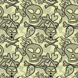 Seamless pattern of comic skulls and bones Royalty Free Stock Photos