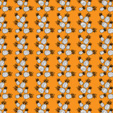 Seamless pattern composed of pineapple. Seamless pattern composed of black and white pineapple on an orange background Stock Image