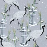 Seamless pattern with cranes and snowfall stock illustration