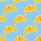 Seamless pattern with croissants. On blue background. Vector texture Stock Photography