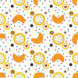Seamless pattern with croissants, cupcakes, coffee cups and colo Stock Photography