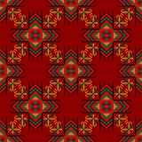 Seamless pattern. The cross-stitch. A bright background. Seamless pattern. The cross-stitch. Yellow, red, green, and black colors. Crafts and Hobbies. A bright Stock Images