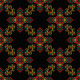 Seamless pattern. The cross-stitch. Crafts and Hobbies. Seamless pattern. The cross-stitch. Yellow, red, green, and black colors. Crafts and Hobbies. A bright Royalty Free Stock Photos