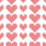 Seamless pattern with cross-stitch hearts on white background. Stock Image