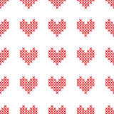 Seamless pattern with cross-stitch hearts on white Royalty Free Stock Images