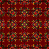 Seamless pattern. The cross-stitch. Yellow, red, green, and black colors. Crafts and Hobbies. A bright background. Symmetrical repetition. Vector illustration Stock Photo