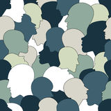 Seamless pattern of a crowd of many different people profile heads. Royalty Free Stock Images