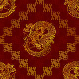 Seamless pattern cunning gold Asian dragon on red. Cunning Asian dragon seamless pattern - gold line on dark red background Stock Image