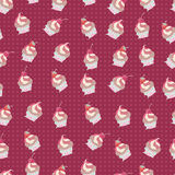 Seamless pattern of cup-cakes. Stock Photography