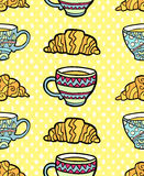 Seamless pattern with cup and croissant on textured yellow background. Stock Images