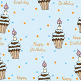 Seamless pattern with cupcake with candle and greeting text. On the blue background. Can be used for printing on fabric, for wrapping paper and for the Stock Images