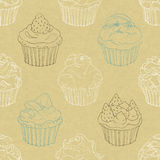 Seamless pattern of cupcakes. On cardboard Stock Images