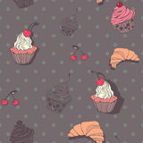 Seamless pattern with cupcakes and croissants in Stock Photos