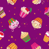 Seamless pattern with cupcakes. Royalty Free Stock Image