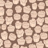 Seamless  pattern with cupcakes in doodle vintage style on brown background. Royalty Free Stock Photography