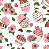 Seamless pattern of cupcakes and flowers Stock Photo
