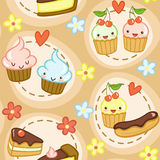 Seamless pattern with cupcakes, flowers and hearts Stock Photos