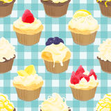 Seamless pattern of cupcakes on gingham check Royalty Free Stock Photo