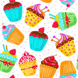 Seamless pattern with cupcakes. Royalty Free Stock Photos
