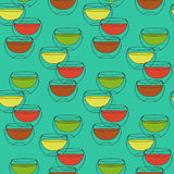 Seamless pattern with cups of tea glass double walled on a turquoise background Royalty Free Stock Image