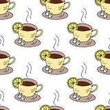 Seamless pattern with cups of tea and lemon. Royalty Free Stock Images