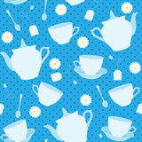 Seamless pattern with cups, teapots and chamomiles Stock Photography