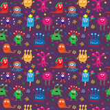 Seamless pattern with cute aliens on a violet background Royalty Free Stock Image