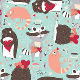Seamless  pattern with cute animals such as raccoon, iguana and hedgehog and penguin with hearts, decorated with doodle star Royalty Free Stock Images