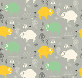 Seamless pattern with cute baby buffaloes and native American sy Stock Images