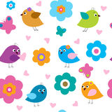 Seamless pattern with cute birds and flowers Royalty Free Stock Photo