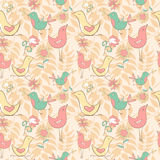 Seamless pattern with cute birds and flowers on the honey backgr Royalty Free Stock Photo