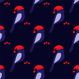 Seamless pattern with cute blue birds in a caps and berries. EPS 10 stock illustration