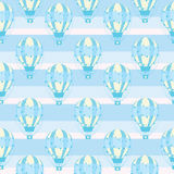 Seamless pattern with cute blue hot air balloon on striped background, vector cartoon, suitable for kid wallpaper and scrap paper Stock Photos