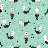 Seamless pattern with cute bunnies mermaids on blue background.  royalty free illustration