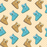 Seamless pattern with cute cartoon boots. Vector illustration Stock Photos