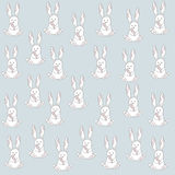 Seamless pattern with cute cartoon bunny. And carrot Stock Photos