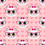 Seamless pattern with cute cartoon cat and heart on pink background. Kitty print Royalty Free Stock Photos