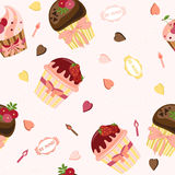 Seamless pattern with cute cartoon cupcakes. Royalty Free Stock Images