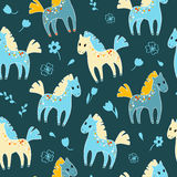 Seamless pattern with cute cartoon horses and flowers. Royalty Free Stock Photos