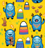 Seamless pattern with cute cartoon monsters Stock Photos