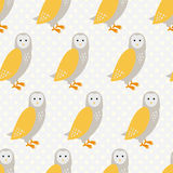 Seamless pattern with cute cartoon owls on grey dotted background. Stock Photography