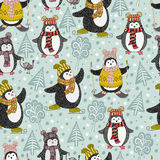 Seamless pattern with cute cartoon penguins Stock Photos