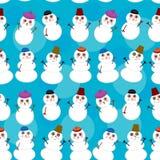 Seamless pattern cute cartoon snowmen on blue Royalty Free Stock Photos