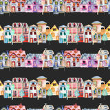 Seamless pattern with cute cartoon watercolor english houses in a row and trees Royalty Free Stock Photos