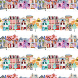 Seamless pattern with cute cartoon watercolor english houses in a row and trees Stock Images