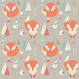 Seamless pattern with cute Christmas baby fox surrounded with fl Royalty Free Stock Photo