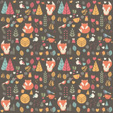 Seamless pattern with cute Christmas baby fox surrounded with fl Royalty Free Stock Photography